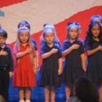 Children singing to honor veterans