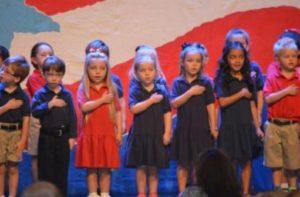 Children standing for national anthem