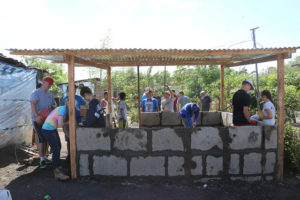 TKA students building a house